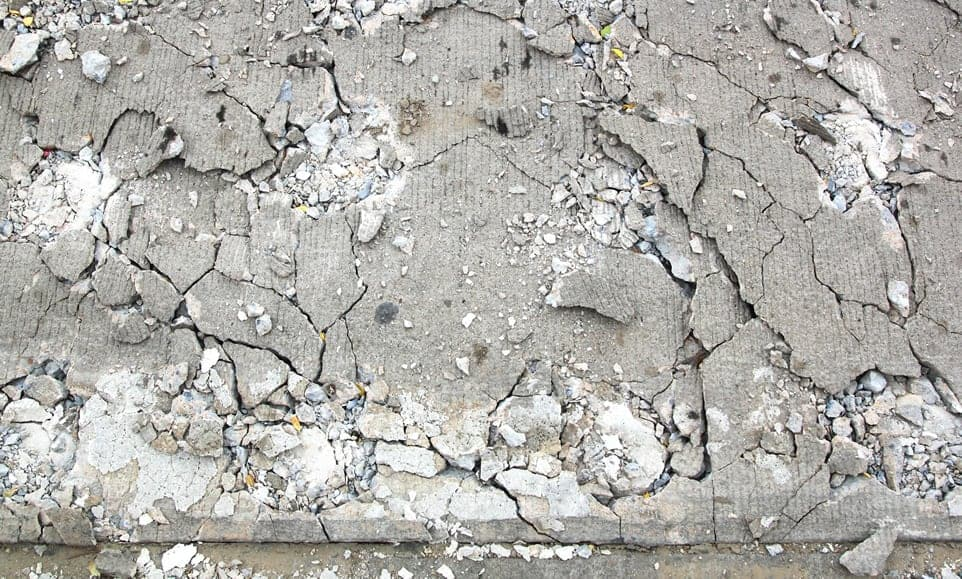 Concrete Road Damaged from Ice Melt, cracked